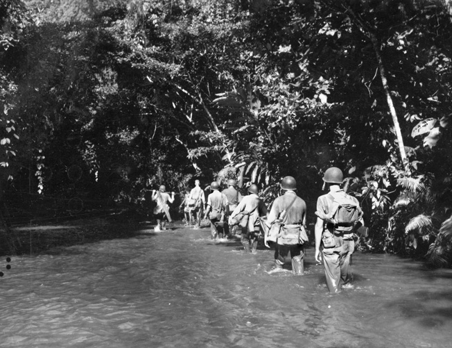 A Marine patrol follows the Tenaru River on the northern coast of Guadalcanal as they search for elusive Japanese artillery pieces.