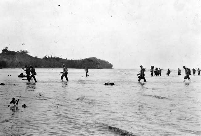 Members of the 2nd Marine Division wade ashore in the shallow waters at Tulagi, August 7 or 8, 1942, against no initial Japanese resistance. The enemy would not remain quiet for long.