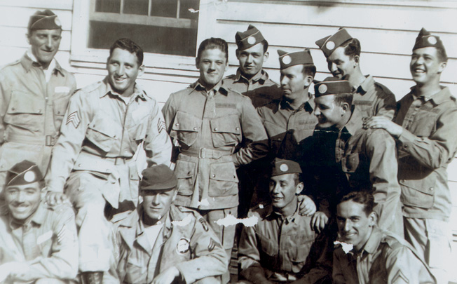 Lud Labutka (standing fourth from left) poses with fellow paratroopers of the 101st Airborne Division during training at Fort Benning. Labutka's close friend Henry Fuller (standing far right) of Wadsworth, Ohio, passed away on March 23, 2003.