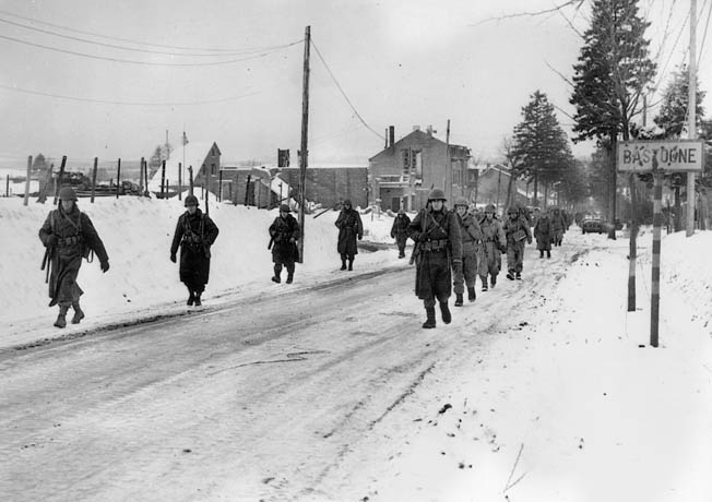 101st soldiers head to the front near Bastogne during the Battle of the Bulge.