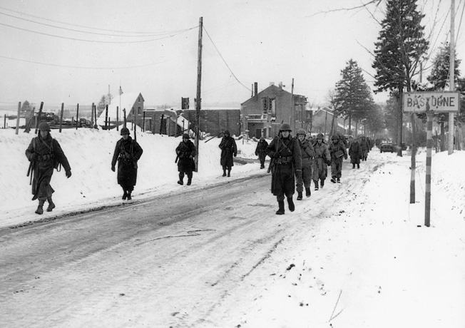 Relieved at last, haggard and war-weary veterans of the epic 101st Airborne defense of Bastogne trudge toward rest and a hot meal. The troopers of the 101st held the encircled crossroads town against repeated German attacks at the height of the Battle of the Bulge. They were ultimately relieved by troops of General George Patton's Third Army.