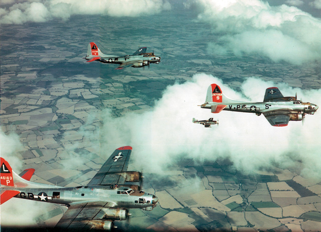 A P51 Mustang fighter escorts Eighth Air Force bombers during a raid on a target deep in Germany. The development of a fighter that could accompany the heavy bombers all the way to and from their targets helped to reduce losses from attacks by German fighters defending their homeland.