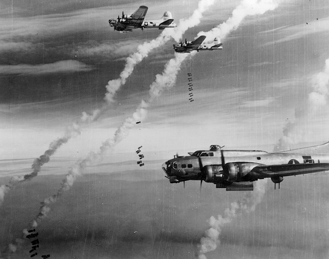 High above Berlin, Eighth Air Force B-17s drop their cargoes of destruction on February 28, 1945. The bombers paid repeated visits to Berlin by day, while the British Royal Air Force bombed German cities by night.