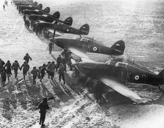 RAF pilots scramble to their Hawker Hurricane fighters to defend the skies over England. Much of the Hurricane was covered with fabric, rather than metal, making it easier to build and easier for ground crews to repair.