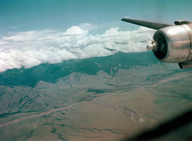 From the air, the jungle-covered Owen Stanley Mountains do not seem as formidable and disease ridden as they are to ground troops trying to cross them.