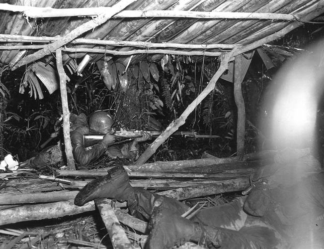 In March 1944, African American soldiers of the Army's 93rd Infantry Division fought alongside the 37th Infantry Division. Here black soldiers from Company K, 25th Infantry Regiment fire on enemy troops in the rain-slicked jungle.