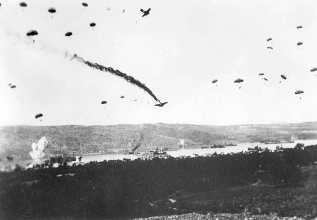 Germans parachute out of a flaming Ju-52 shot down over the Akrotiri Peninsula near Canea, between Maleme to the west and Suda to the east.