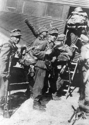 Loaded with equipment, German mountain troops or gebirgsjager, clamber aboard a Ju-52 transport aircraft in preparation for the assault on Crete.
