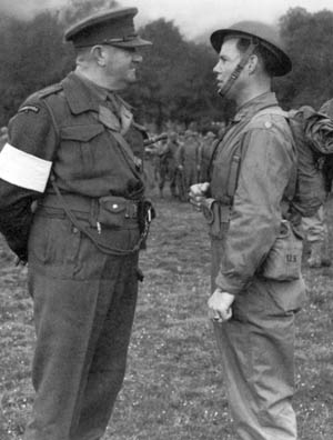 Major William Darby of the Rangers (right) talks with Lt. col. Charles Vaughan, head of British Commando training, in July 1942.