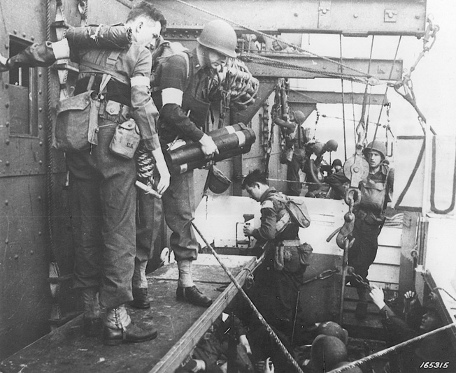 U.S. Army Rangers move themselves and an array of military equipment into landing craft prior to the beginning of Operation Torch. This photo was taken on November 6, 1942, two days before the landings on the African continent.