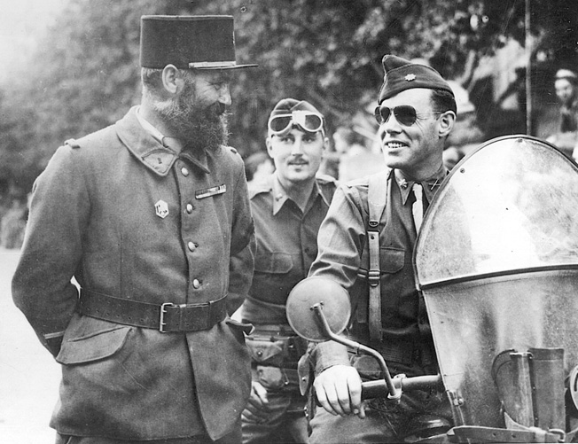 Lt. Col. William Darby (right) talks with French soldiers wearing the distinctive kepi and a full beard at the height of the campaign against the Germans in North Africa, December 18, 1942.