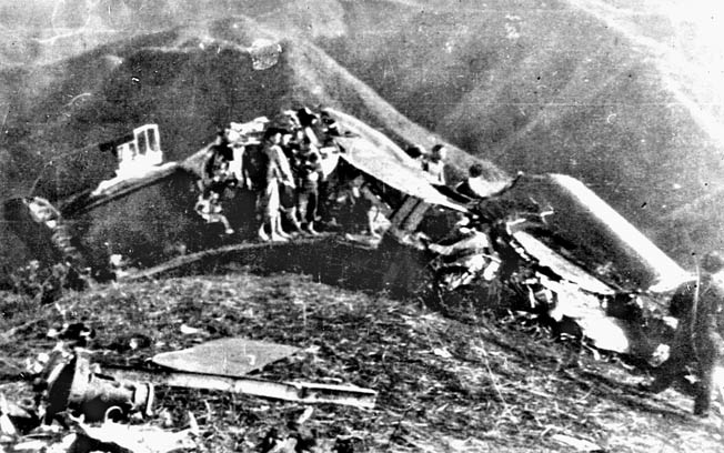 Wreckage of Doolittle's plane on a Chinese hillside. Doolittle can be seen center right.