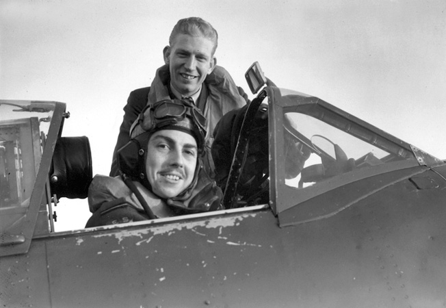 Flying Officer G.A. Daymond (seated in cockpit) and Flight Lt. C.G. Peterson of the Eagle Squadron were both awarded the Distinguished Flying Cross.