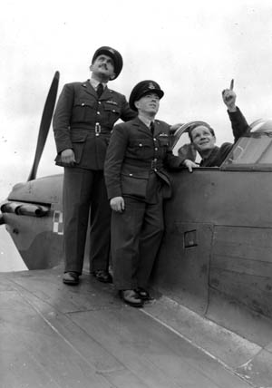 Pilot Officers Andrew Mamedoff, Vernon Charles Keough, and Gene Tobin gaze skyward hours before they began flying fighter planes for the RAF.