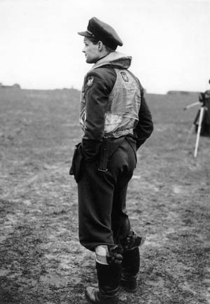 Pilot officer Red Tobin, wearing his RAF uniform, stands at the edge of an English airfield. Tobin was one of many young American fliers who went to war for Britian prior to U.S. entry into the struggle against the Nazis.