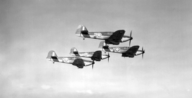 Prospective Eagle Squadron pilots were required to undergo standard RAF flight training even though they already held certifications. In this photo American pilots fly trainers in formation above an RAF flight training school.
