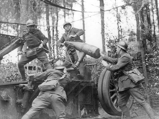 French gunners load a 12cm gun to beat back a German attack, May 22, 1940.