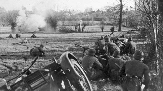 A German motorcycle infantry platoon knocks out a French machine-gun position on the outskirts of a village.