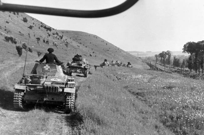 In a photograph taken by Maj. Gen. Erwin Rommel, commander of the 7th Panzer Division that spearheaded one of the drives into France, German tanks roll through the French countryside.