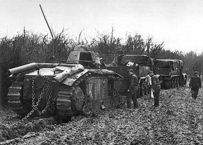 The spoils of war, abandoned French tanks are towed to a railway station for transport to Germany. Along with thousands of men killed, wounded, or captured, the Allies lost vast quantities of war materiel with the fall of France.