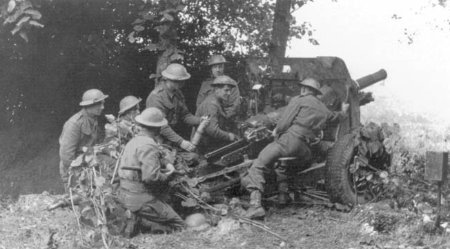 Rushed to the continent to help stem the German invasion, the British Expeditionary Force soon found its positions untenable. Here British gunners shell the enemy in Belgium, May 30, 1940.