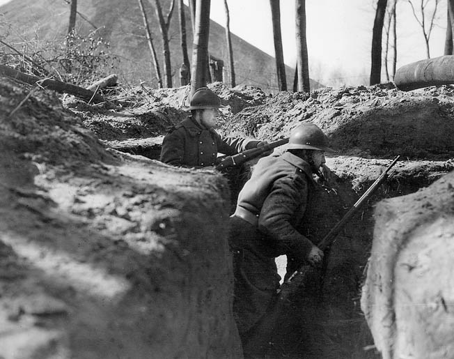 French infantrymen in a Maginot Line trench are on the alert for an attack that never came. The Germans simply avoided the border fortifications and plunged through Belgium and into France.
