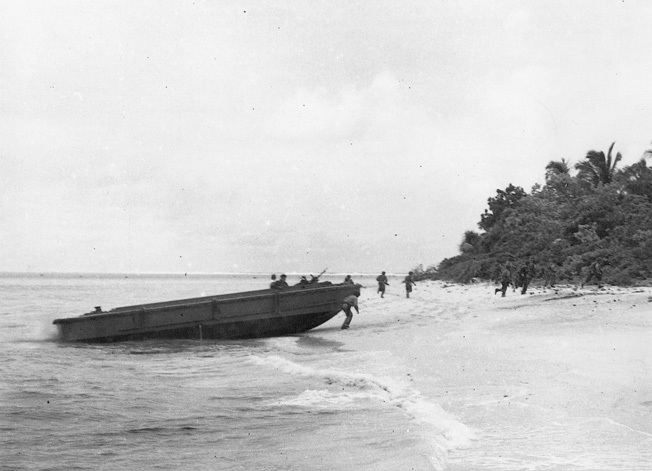 Moving quickly from their landing craft and into the relative safety of the jungle, American troops head toward their objective on the strategically vital island of Guadalcanal.