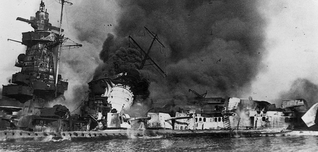 Shortly after charges placed to scuttle the pocket battleship in the estuary of the River Plate were detonated, the Graf Spee burns and settles in relatively shallow water off the coast of Uruguay on December 18, 1939.