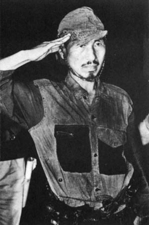 Second Lieutenant Hiro Onoda salutes upon his return to Japan in March 1974 after years of hiding in the jungles of the Philippines.