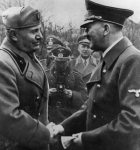 On one of his many state visits to Germany, Italian dictator Benito Mussolini greets his Nazi benefactor, Adolf Hitler.