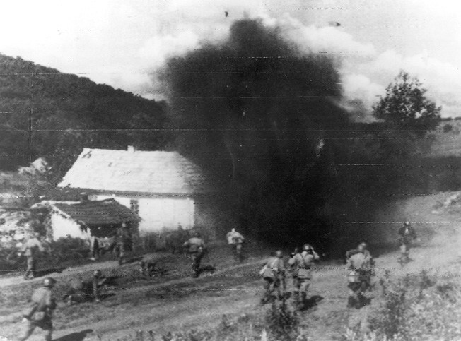 On July 24, 1944, a contingent of Red Army soldiers moves past a damaged farm and toward German positions under constant bombardment from well-placed artillery. The German 88mm cannon was a multipurpose weapon, effective against aircraft, armor, and enemy troops.