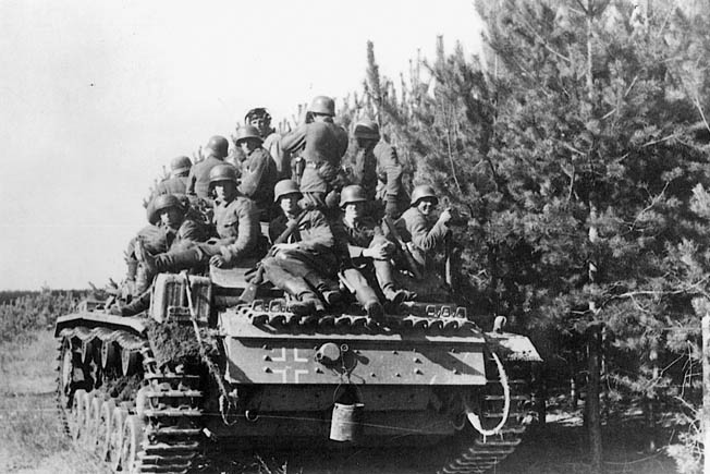 erman panzergrenadiers hitch a ride on a panzer. In early 1943 Strachwitz commanded the panzer regiment of the elite Grossdeutschland Division and played a key role in the German victory in the Third Battle of Kharkov.