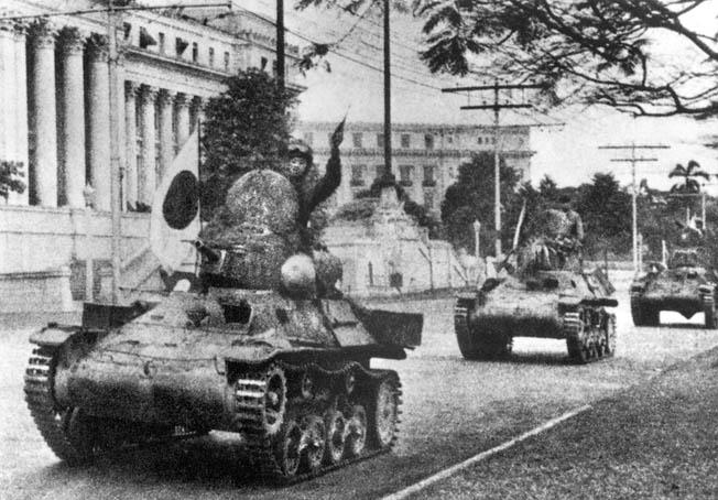 Japanese tanks roll past government buildings in the now-occupied capital of Manila.