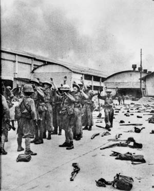 After being ordered by Percival to cease resistance, British soldiers surrender in Singapore on February 15, 1942. Many were sent to slave-labor work camps.