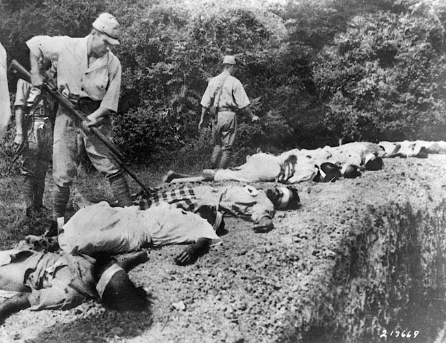 The Japanese army committed numerous atrocities during its invasion of Malay. Here, a soldier bayonets the body of a prisoner, one of a group executed by firing squad near Singapore.