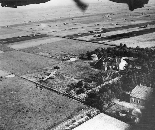 Consolidated B-24 Liberator bombers of the U.S. Army Air Forces fly over the Market-Garden glider landing zones in Holland while on their way to bomb a distant target on September 18, 1944.