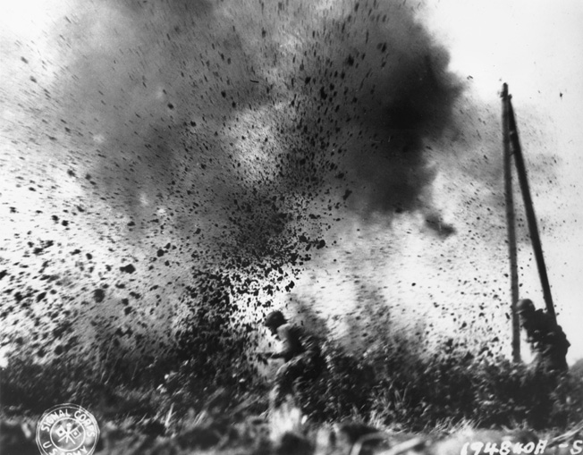An advancing American paratrooper narrowly escapes an exploding round from a German 88mm gun.
