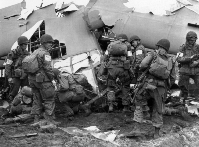 Soldiers of the 82nd Airborne unload their wrecked glider after a controlled crash in a Dutch field at the opening of Market-Garden.