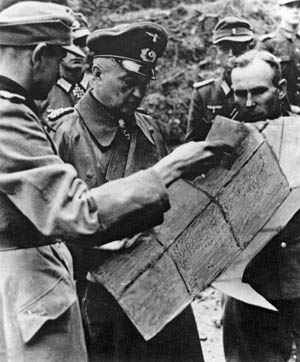 German Field Marshal Walther Model visits a forward command post of a Volksgrenadier division on the Western Front, October 18, 1944.