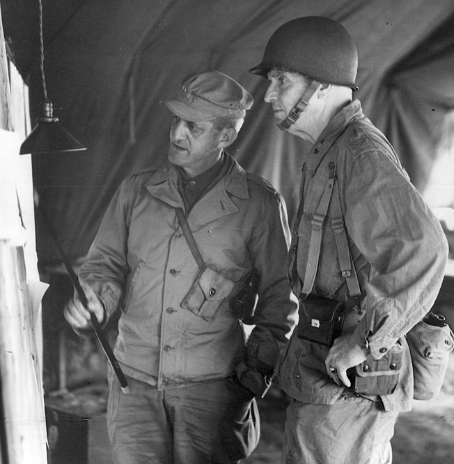 General Simon Bolivar Buckner, son of a Confederate Civil War general, confers with General John R. Hodges on Okinawa.