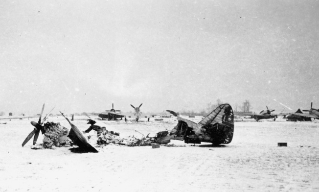 A P-47 of the 368th Fighter Group lies shattered at its base in Metz, France, following an early morning German raid.