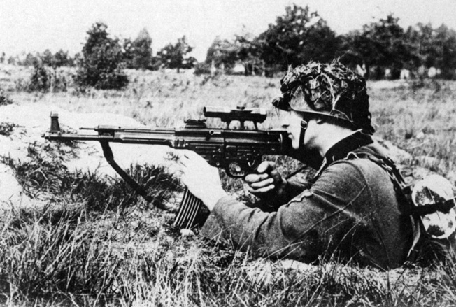 A German soldier tests an MP43/1 for suitability as a sniper weapon in October 1943.