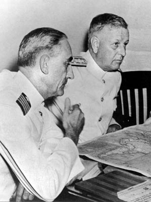 "Admiral Husband E. Kimmel (right), in command of the U.S. Pacific Fleet on the ""day of infamy,"" shown with his operations officer, Captain Walter S. DeLany, five days before the attack."