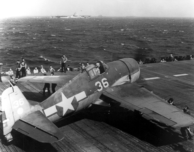 Following a successful raid against targets in the Marianas, a Grumman F6F Hellcat fighter sets down on the USS Hornet. A tough, powerful fighter, the Hellcat ultimately dominated the skies over the Pacific.