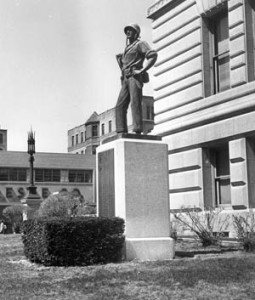 The statue of Marine Lieutenant John V. power stands larger than life on the lawn in front of City Hall in Worcester, Massachusetts.
