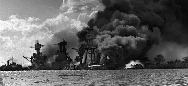 Three stricken battleships (from left): West Virginia, Tennessee, and Arizona still afire late on December 7. Only the Arizona would not live to fight another day.