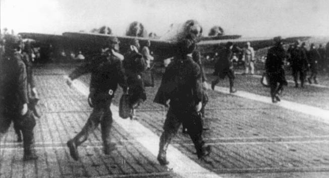 "Japanese airmen take to their planes for ""Operation Hawaii,"" the attack on Pearl Harbor. The Japanese fleet sailed through storm and fog across the North Pacific and away from the normal sea lanes to arrive undetected 200 miles from Hawaii early on the morning of December 7."
