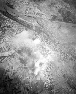 A pall of smoke rises from the manufacturing center of Schweinfurt as Eight Air Force bombers deliver their payloads.