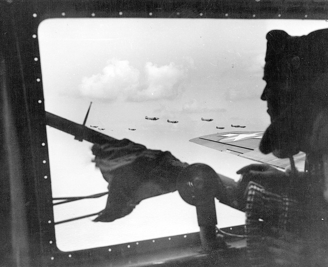 Peering from his gun position in an American bomber, an alert airman scans the skys for enemy fighter aircraft during a mission deep in Germany.