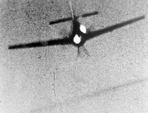 Caught by American fighter planes, a German Focke-Wulf starts a long downward spiral as flames begin to flicker underneath the stricken fuselage.